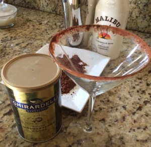Using a clean finger, rub the inside and outside of the rim with simple syrup and then dip into cocoa until rim is covered on the inside and out.